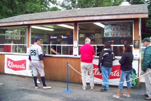 Kernels pitcher Donn Roach waits for his food while fans order theirs. (Photo by Craig Wieczorkiewicz/The Midwest League Traveler)
