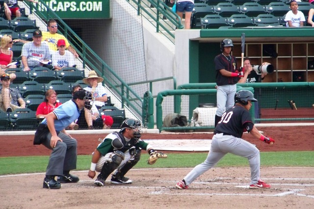 Kolten Wong attempts to lay down a bunt for the Quad Cities River Bandits in 2011. (Photo by Craig Wieczorkiewicz/The Midwest League Traveler)