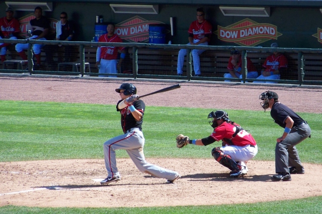 Then-Lansing Lugnuts infielder Andy Burns connects with a pitch during a game at Dow Diamond in 2012. (Photo by Craig Wieczorkiewicz/The Midwest League Traveler)