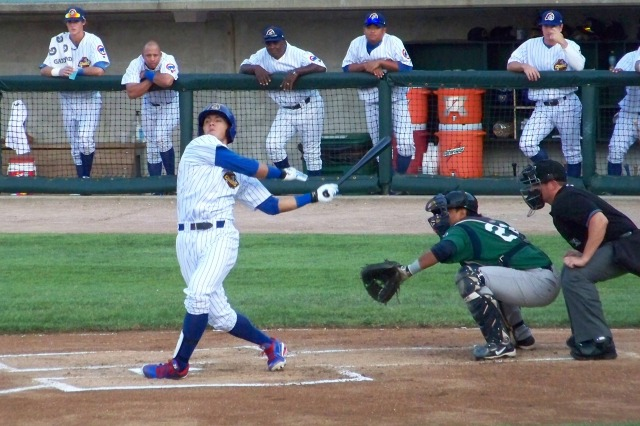 Javier Baez swings at a pitch while playing for the Peoria Chiefs last year.