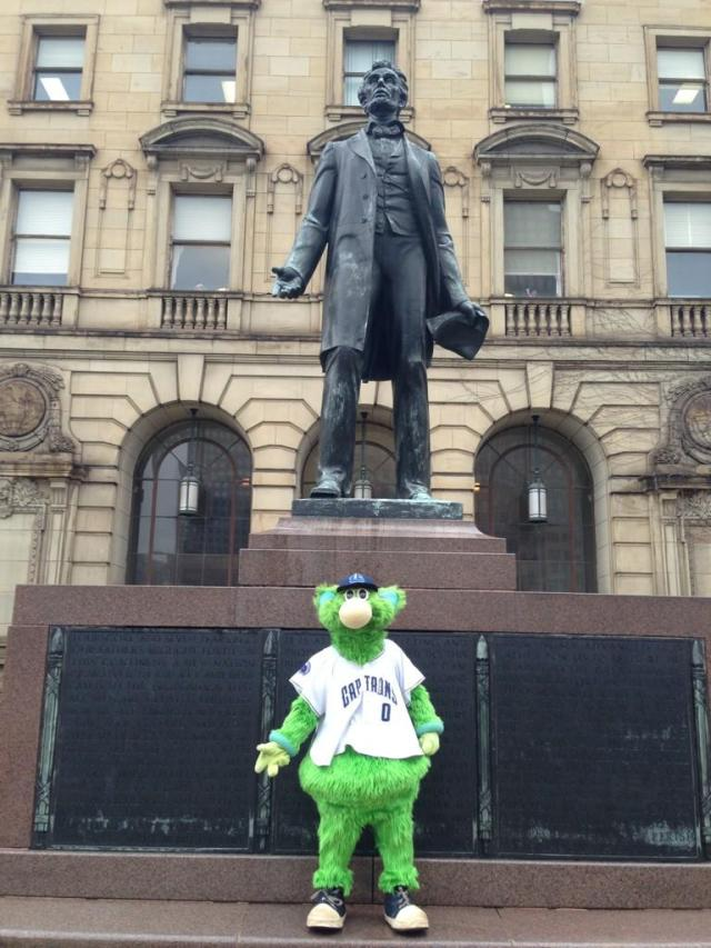 Skipper strikes a presidential pose beneath an Abraham Lincoln statue in Cleveland.