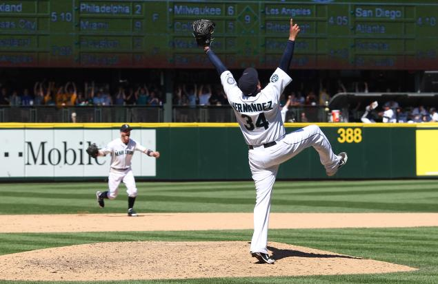Felix Hernandez celebrates after pitching a perfect game last August. (Photo by Otto Greule Jr./Getty Images)
