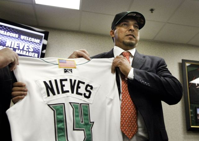 Jose Nieves holds up the jersey he will wear as manager of the Dayton Dragons. (Photo courtesy of the Dayton Daily News)