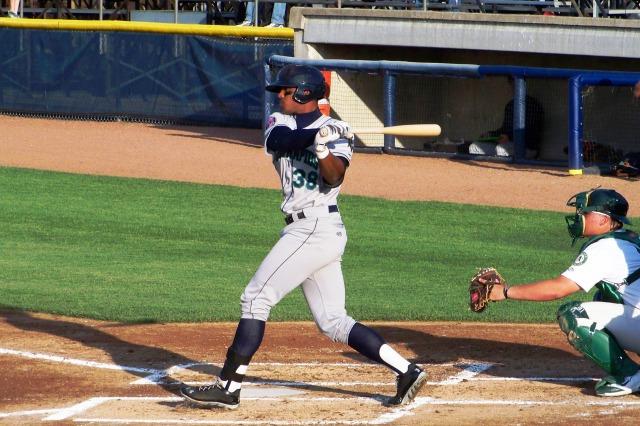 Cedar Rapids Kernels RF Adam Brett Walker swings at a pitch.