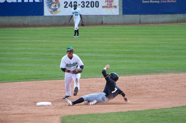 Hot Rods LF Marty Gantt slides into 2B during a game against the LumberKings earlier this month.