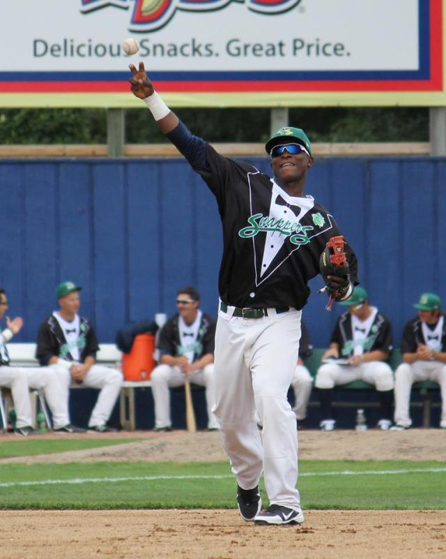 Miguel Sano looks dapper making a play at third base in 2012. (Courtesy of Rinaldi Photos)