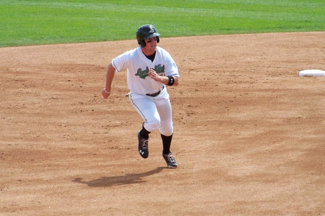 Patrick Kivlehan breaks for third base during a Clinton LumberKings game in 2013. (Photo by Craig Wieczorkiewicz/The Midwest League Traveler)