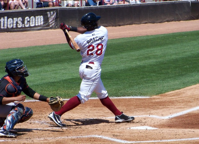 Wisconsin Timber Rattlers LF Victor Roache fouls off a pitch in Appleton earlier this year.