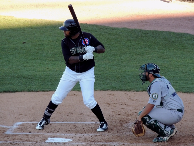 Kane County Cougars DH Rock Shoulders bats during Thursday's game.