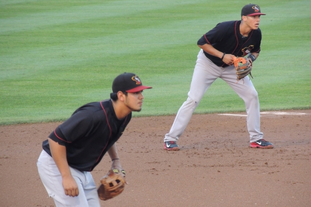 Carlos Correa (right) and Rio Ruiz playing shortstop and third base, respectively, for the 2013 Quad Cities River Bandits. (Photo by Craig Wieczorkiewicz/The Midwest League Traveler)