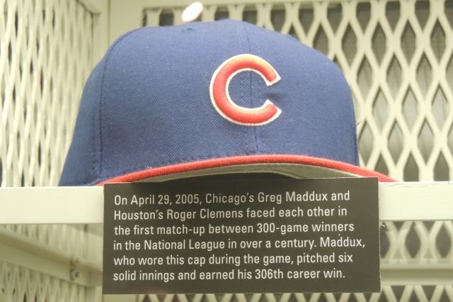 One of Greg Maddux's caps on display at the Baseball Hall of Fame. (Photo by Craig Wieczorkiewicz/The Midwest League Traveler)