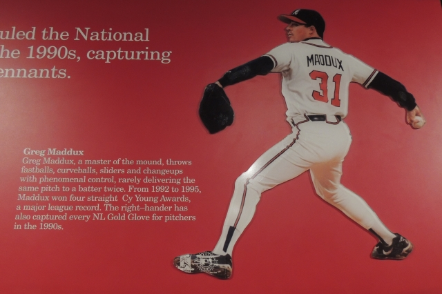Greg Maddux is part of a Baseball Hall of Fame display about the Atlanta Braves of the 1990s.