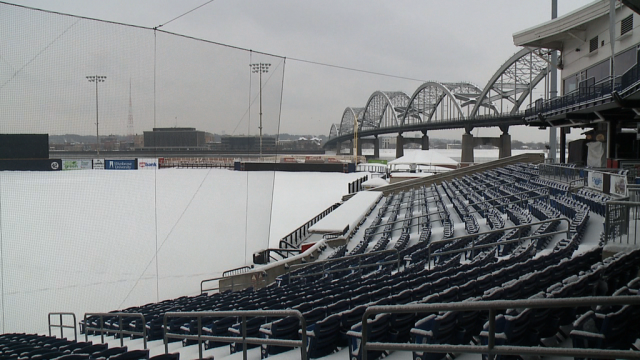 Modern Woodmen Park sports a fresh layer of snow late Saturday afternoon.