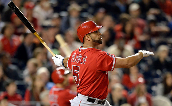 Angels slugger Albert Pujols hits his 500th career home run in the fifth inning of Tuesday's game against the Washington Nationals. (Photo by Patrick Smith/Getty Images)