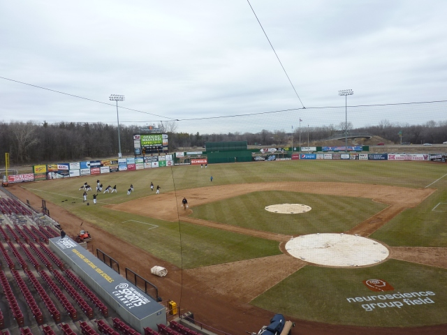 The Wisconsin Timber Rattlers start stretching on the newly-renamed Neuroscience Group Field at Fox Cities Stadium.