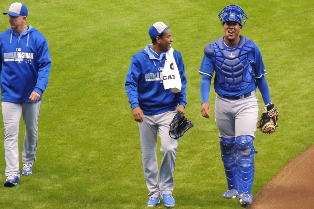 Salvador Perez (right) and Yordano Perez share a laugh on their way from the bullpen to the dugout before Saturday's game.
