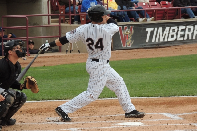 Timber Rattlers RF Michael Ratterree fouls back a pitch.