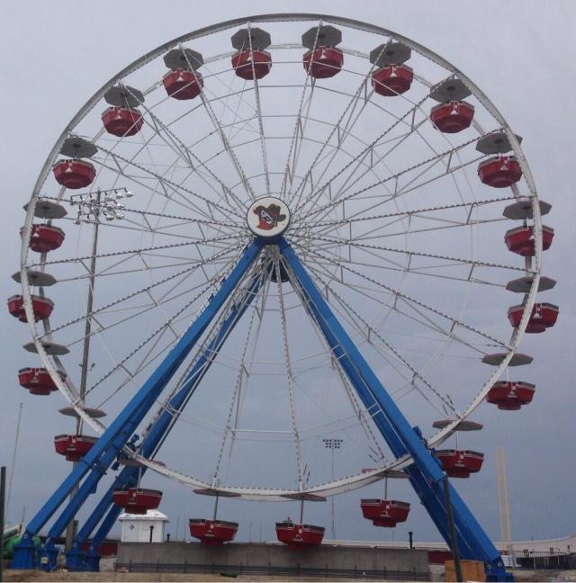 Gondolas were added to the Ferris wheel Monday. (Quad-City Times photo by John Blunk)
