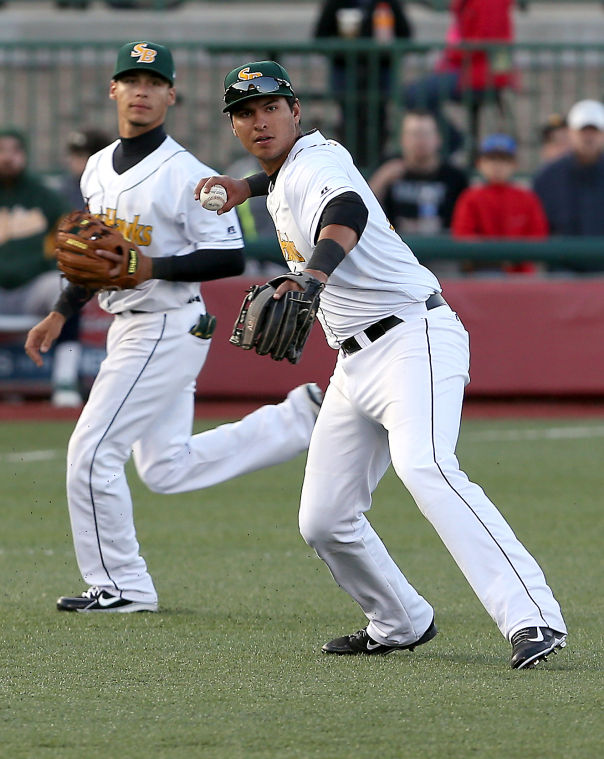 Silver Hawks 3B Joe Munoz (right) handles a ground ball while SS Andrew Velazquez backs him up during South Bend's home opener last month. (South Bend Tribune photo by Greg Swiercz)