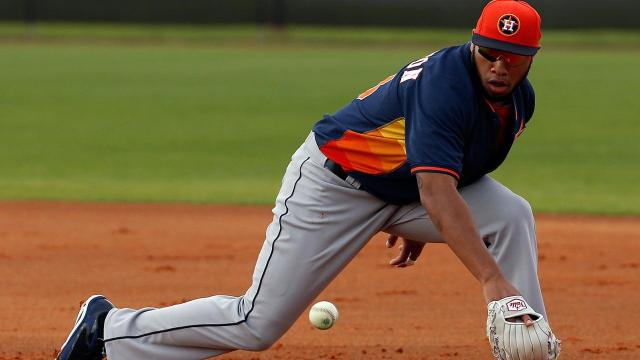 Jon Singleton fields a ground ball during Astros spring training earlier this year. (AP Photo/Alex Brandon)