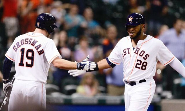 Jon Singleton (right) is congratulated by teammate Robbie Grossman after hitting a home run in his MLB debut with the Astros. (AP photo by Bob Levey)