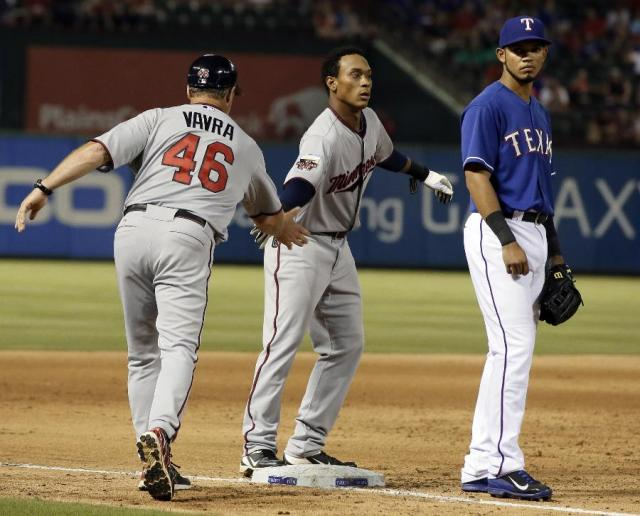 Twins 3B coach Joe Vavra congratulates Jorge Polanco on his first MLB hit Friday. (AP photo by Tony Gutierrez)