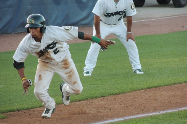 Snappers SS Melvin Mercedes breaks for home after LumberKings SP Seon Gi Kim threw a wild pitch. Mercedes scored.
