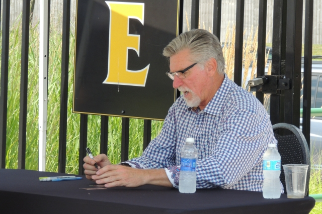 Former MLB pitcher Jack Morris signing autographs during Monday's game at Four Winds Field.