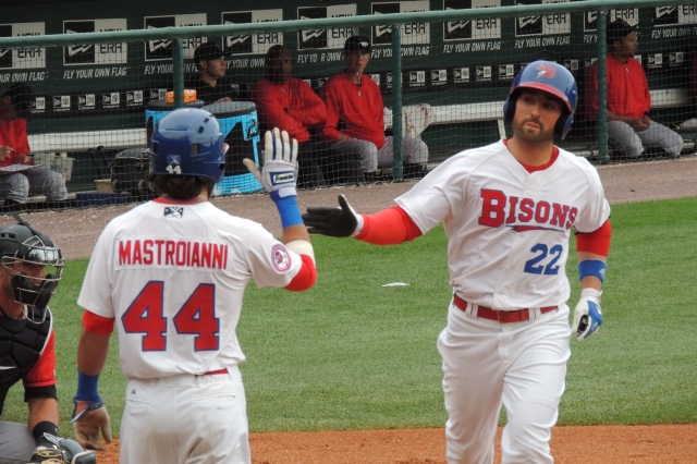 Former Lansing Lugnuts OF Kevin Pillar is greeted at the plate by teammate Darin Mastroianni after Pillar clubbed a 2-run homer for the Buffalo Bisons during a game last July. (Photo by Craig Wieczorkiewicz/The Midwest League Traveler)