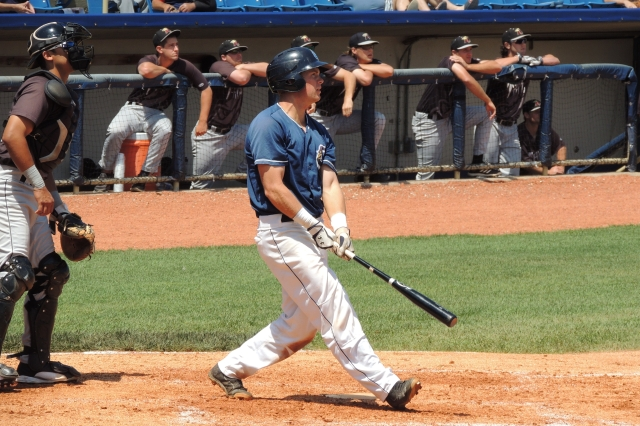 Lake County Captains C Richard Stock follows through with his home run swing in the bottom of the 8th inning.