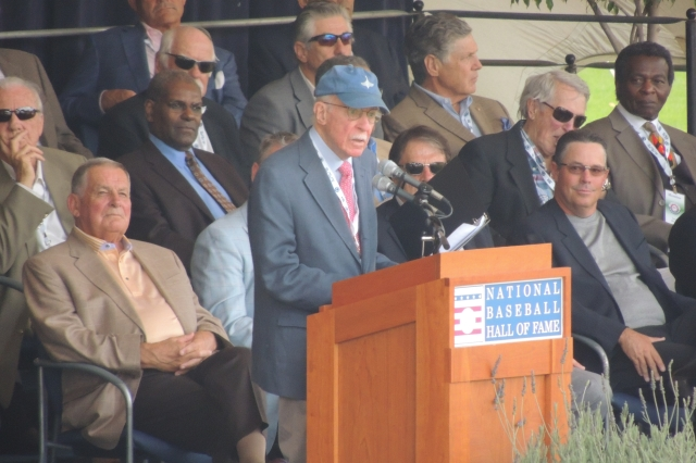 J. G. Taylor Spink Award winner Roger Angell delivers his acceptance speech in front of a stage full of Baseball Hall-of-Famers.
