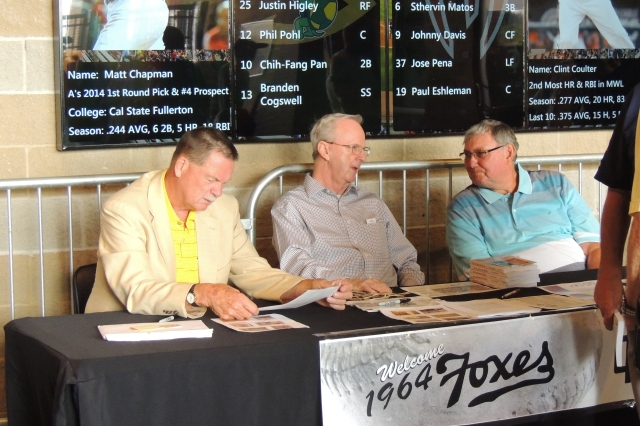 From left: Former 1964 Fox Cities Foxes pitchers Hank King, Tim Sommer and Ed Petryshyn signed autographs on the concourse before the game.
