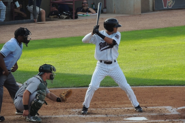 Wisconsin Timber Rattlers SS Angel Ortega batting in the bottom of the 3rd inning, right before he hit a solo homer.