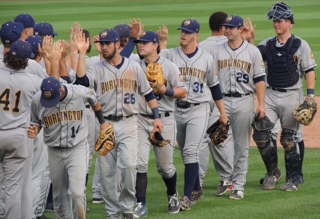 The Burlington Bees celebrate their 5-4 win over the Quad Cities River Bandits.