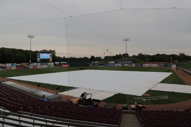The tarp was on the field before Thursday's game in Appleton, and it rained during part of the game, but the Timber Rattlers were able to get their game in. (Photo by Craig Wieczorkiewicz/The Midwest League Traveler)