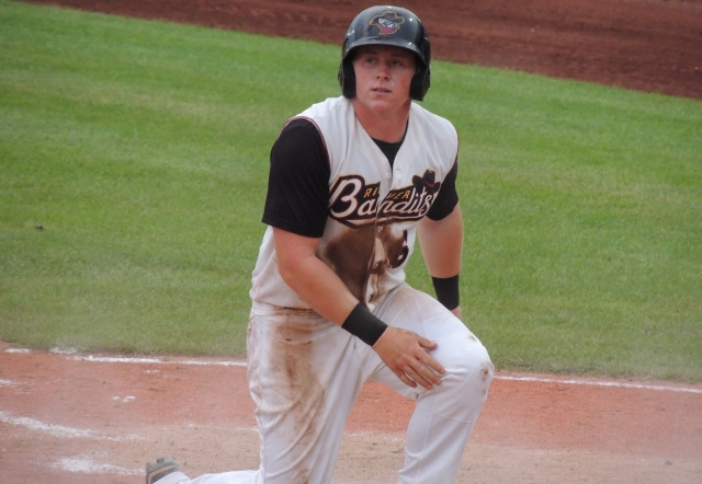 River Bandits 2B Marc Wik was thrown out at the plate by LumberKings RF Tyler O'Neill.