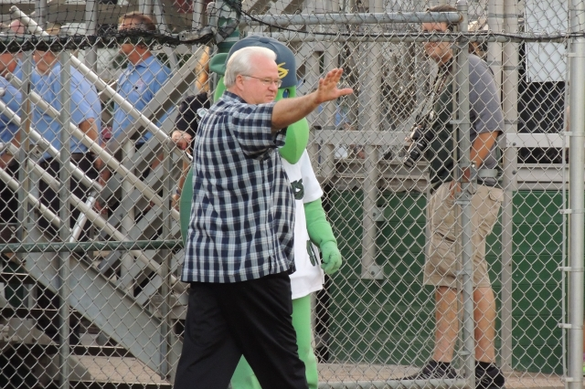 Minor League Baseball President Pat O'Connor waves after speaking to the crowd about Midwest League President George Spelius.