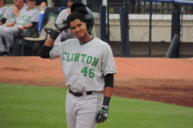 Clinton LumberKings LF Wilton Martinez takes off his helmet after making the last out of the 4th inning.