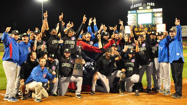 The 2014 Midwest League champion Kane County Cougars pose with the championship trophy. (Photo by Lianna Holub/MiLB.com)