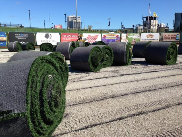 Rolls of artificial turf removed from the playing surface of Four Winds Field today. (Photo courtesy of WNDU-TV)
