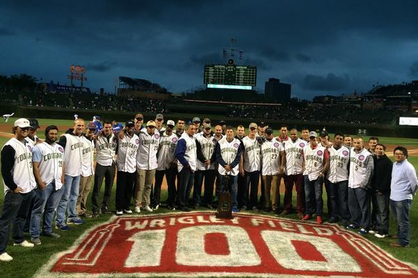 The 2014 Kane County Cougars pose with their Midwest League championship trophy at Wrigley Field earlier this month. (Photo courtesy of the Chicago Cubs)
