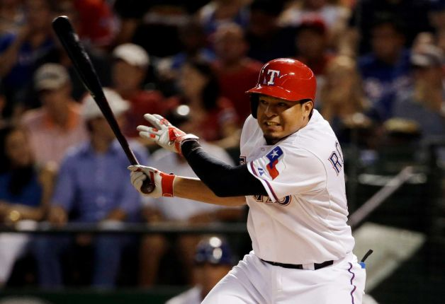 Texas Rangers INF Guilder Rodriguez follows through on his first MLB hit Monday. (Photo by Tony Gutierrez/Associated Press)