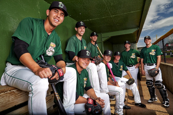 LumberKings (from left) Lonnie Kauppila, Justin Seager, Jeff Zimmerman, Ian Miller, Zach Shank, Emilio Pagan, manager Scott Steinmann, and Marcus Littlewood posed for this photo in their home dugout for a Sports Illustrated article about Clinton's 16-run comeback. (Photo by Dilip Vishwanat /Sports Illustrated/Getty Images)