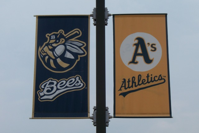 Bees and Athletics banners hung together outside Burlington's Community Field in 2011, when the two teams were still affiliated. (Photo by Craig Wieczorkiewicz/The Midwest League Traveler)