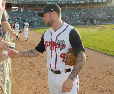 Brett Lawrie signs an autograph during his 2012 rehab stint with the Lansing Lugnuts. (Photo by Larry Hook/MLive.com)
