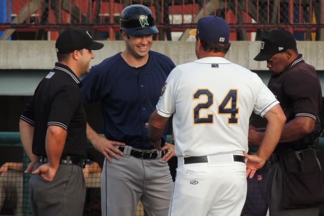Kernels skipper Joe Mauer shares a laugh with then-Bees manager Bill Richardson (No. 24) before a game in Burlington this year. (Photo by Craig Wieczorkiewicz/The Midwest League Traveler)