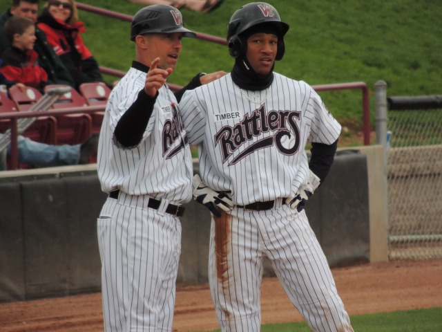 Timber Rattlers manager Matt Erickson talks to Brewers prospect Johnny Davis at third base during a game last May. (Photo by Craig Wieczorkiewicz/The Midwest League Traveler)