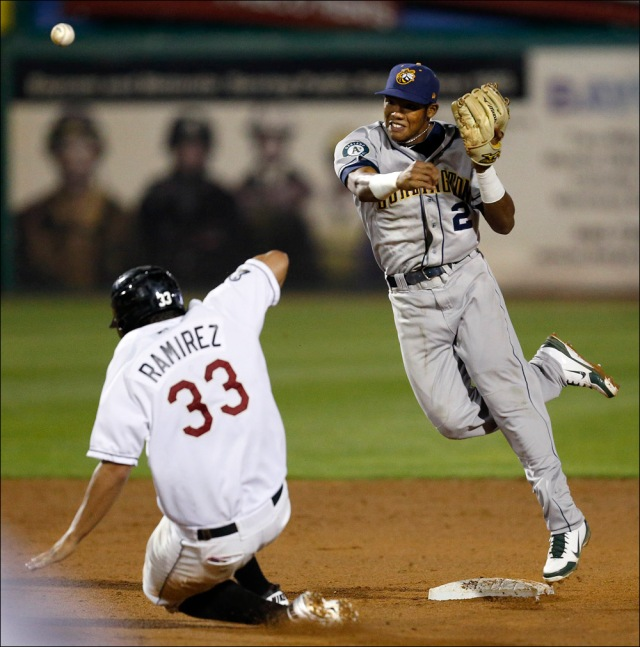 The Wisconsin Timber Rattlers' Nick Ramirez is out at second base against the Burlington Bees' Addison Russell during a Midwest League playoff game in 2012. (Photo by Dan Powers/The Post-Crescent)