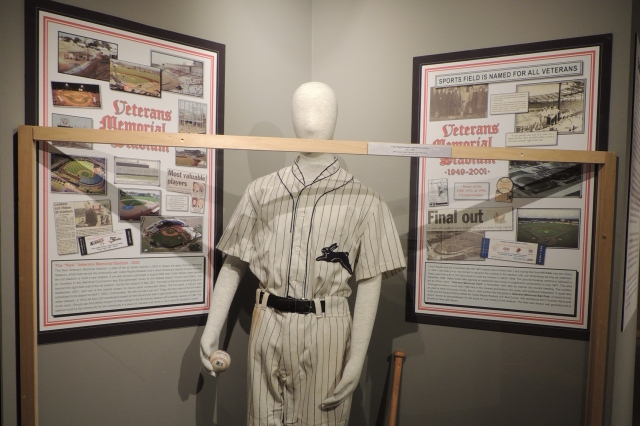 This part of the exhibit features a replica 1906 Cedar Rapids Bunnies uniform. The Bunnies were part of the now-defunct Three-I League.