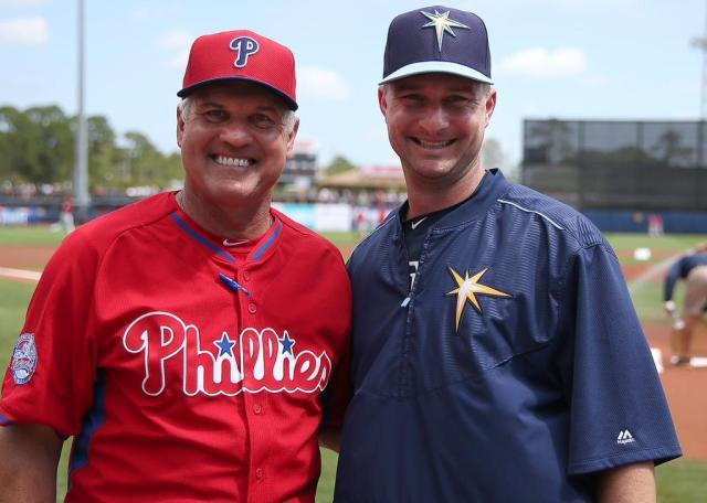 Philadelphia Phillies manager Ryne Sandberg (left) and Durham Bulls skipper Jared Sandberg